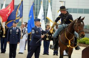 Command command senior enlisted leader, hands the Noncommissioned Officer's Sword to a service member