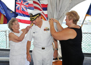 A Captain promoted to Rear Admiral in a ceremony