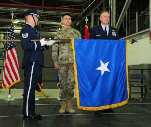 A Brig. Gen. is presented with a flag during his promotion ceremony to the rank of brigadier general