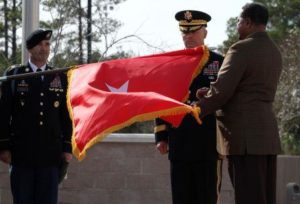 Unfurling of a general officer flag during the a general's promotion ceremony.