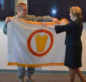 Senior Executive Service flag during an induction ceremony
